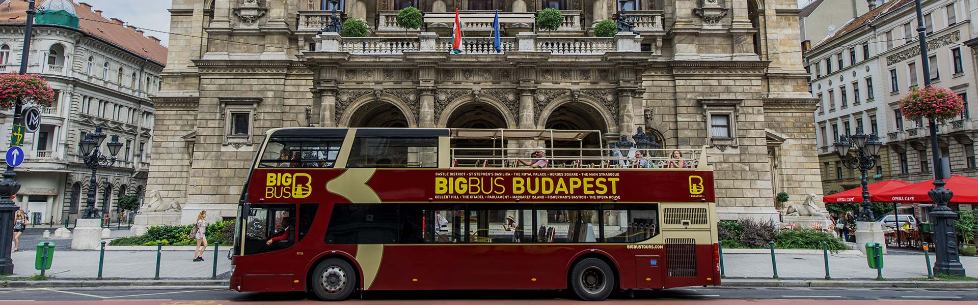 Man listening to commentary on a bus in Budapest