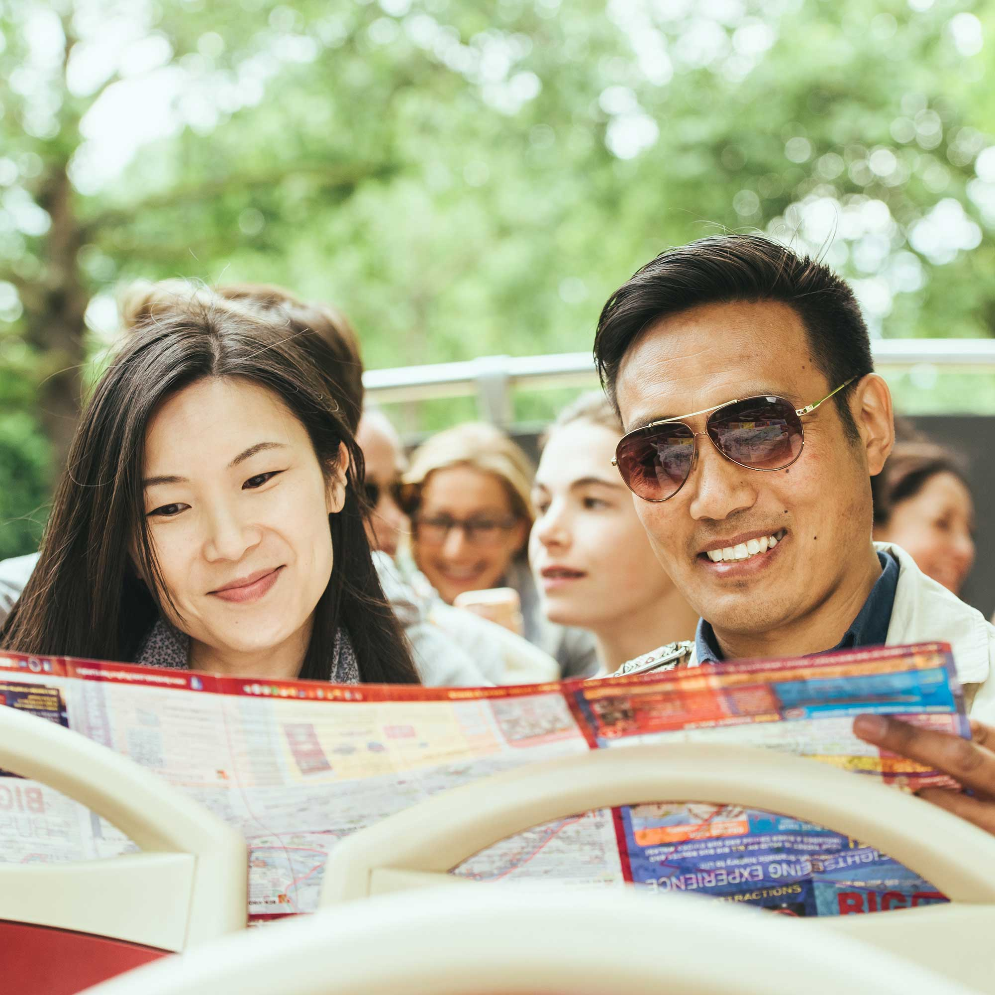 Couple looking at a map on Big Bus