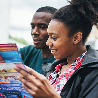 Couple looking at London tour map