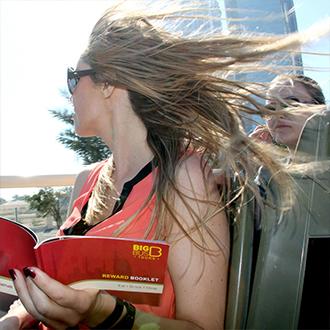 Woman on Big Bus Abu Dhabi open-top sightseeing tour