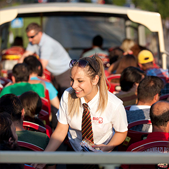 Big Bus Budapest staff helping passengers on a bus in Budapest