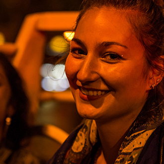 Woman on night bus tour in Paris