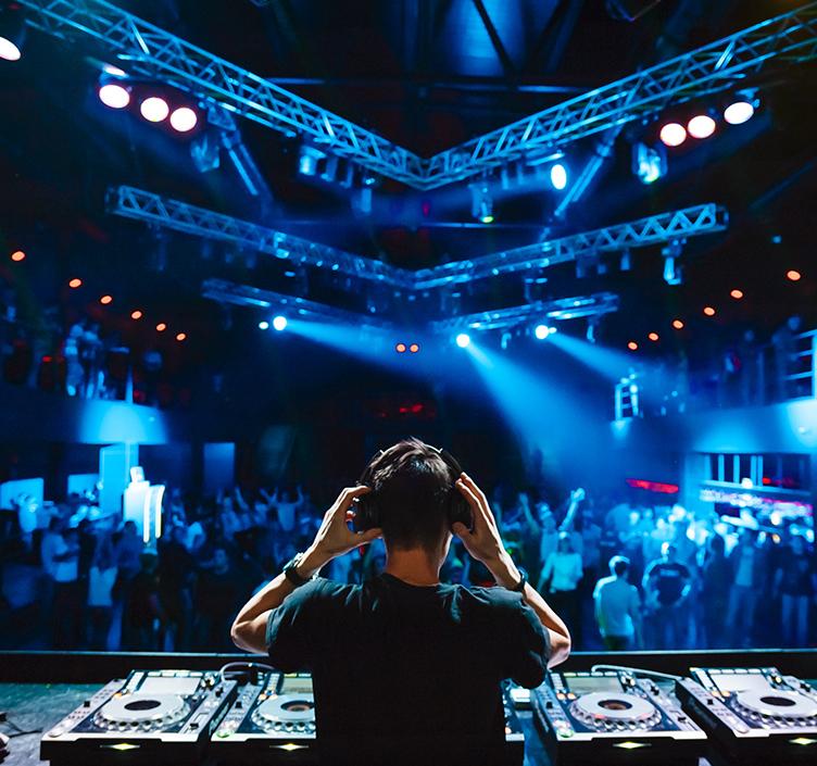 DJ playing to a club