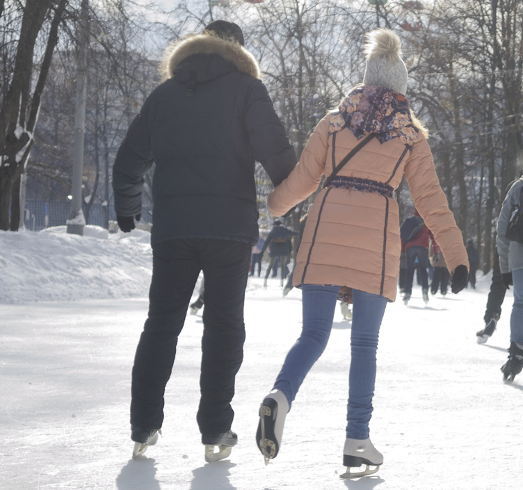 Couple ice skating outdoors