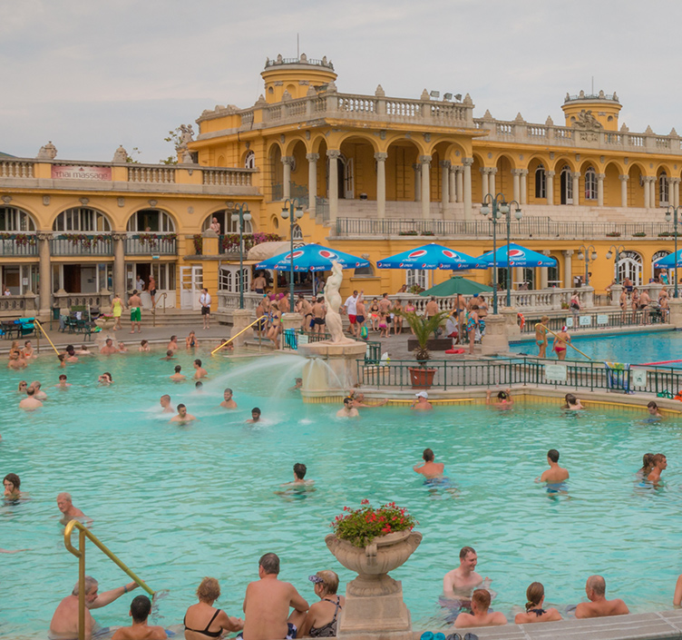 People swimming in the Széchenyi Bath in Budapest