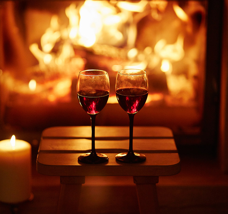 Cosy drink in front of a log fire
