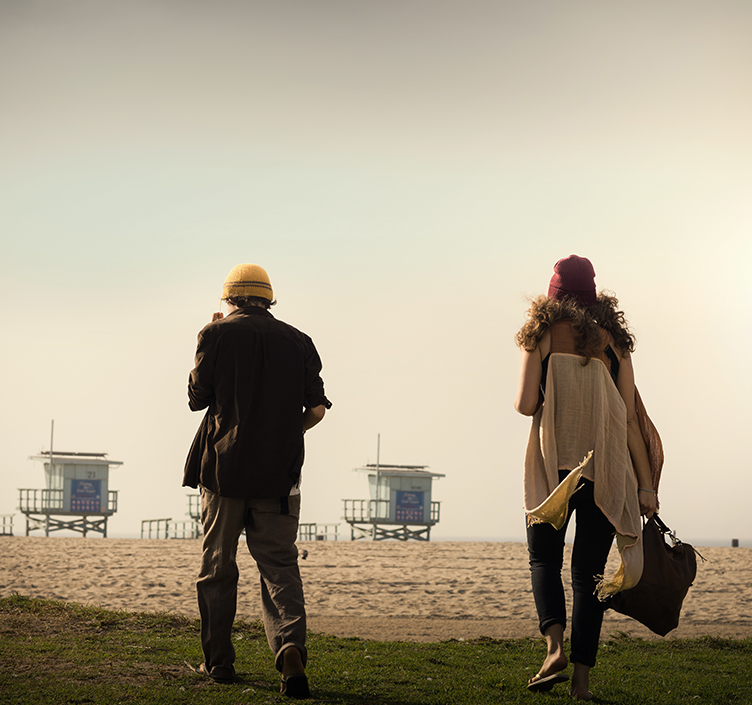 Couple walking on Venice Beach in winter