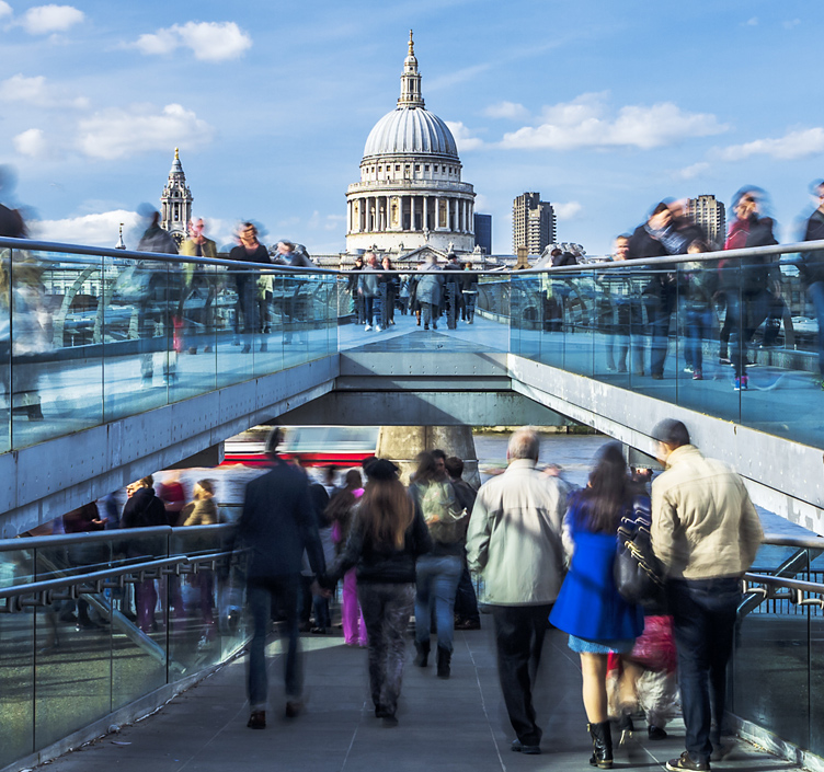 Crowded bridge with a view of St Paul's in London