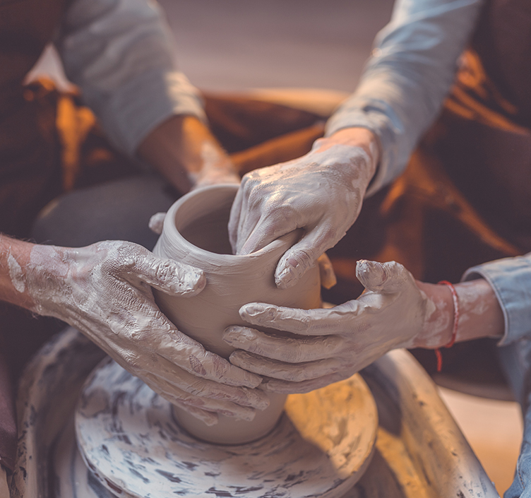 Couple pottery making together