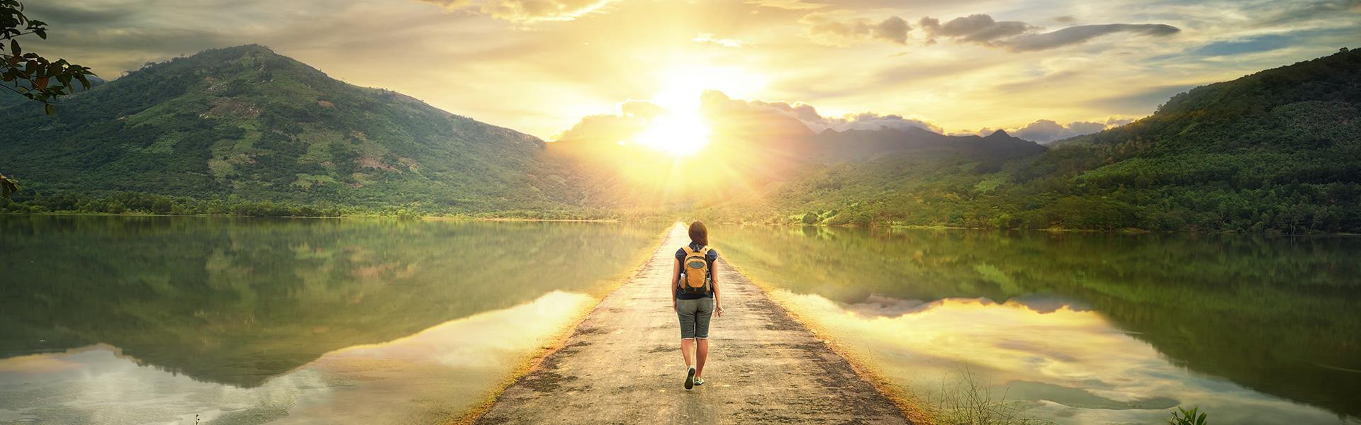Traveller walking over a beautiful lake