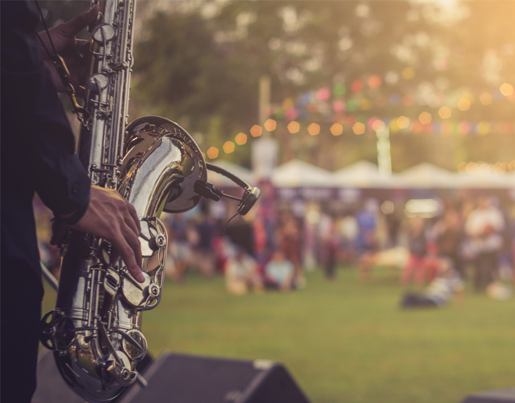Jazz player playing the trumpet at a festival