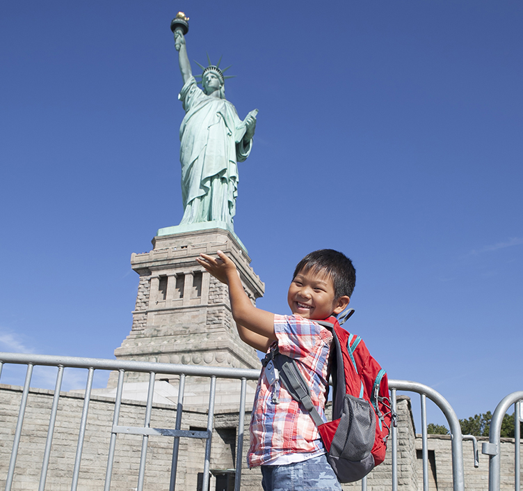 Child propping up the Statue of Liberty