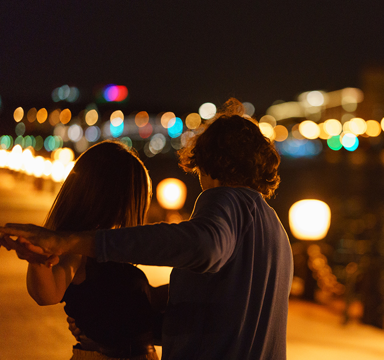 Couple dancing outdoors in the evening