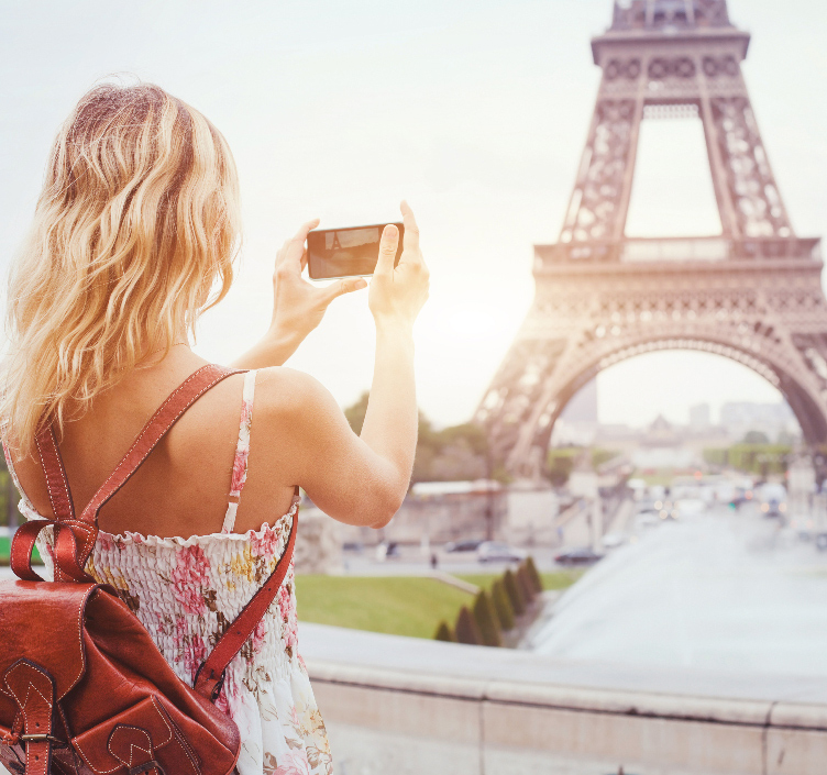 Girl taking picture of Eiffel Tower