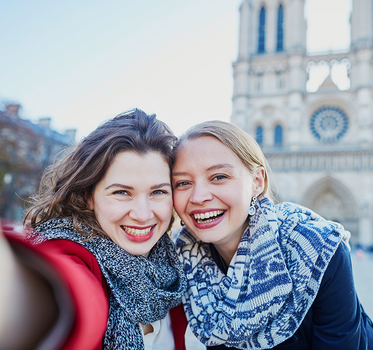 Ladies taking a selfie in front of the Notre Dame