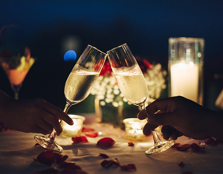 Champagne cheers in a romantic restaurant