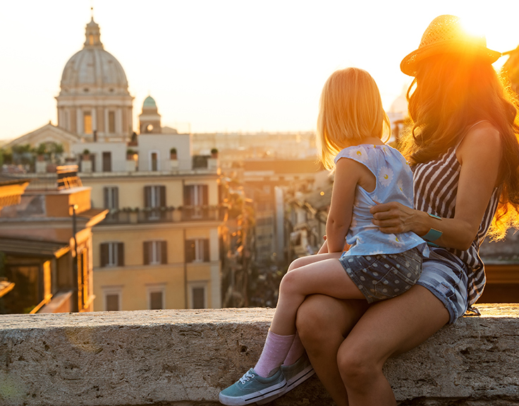 Mother and child looking out over Rome