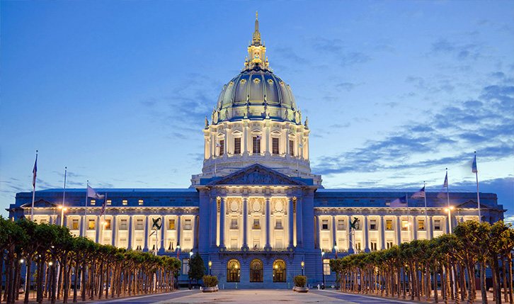 Civic Center lit up at night in San Francisco