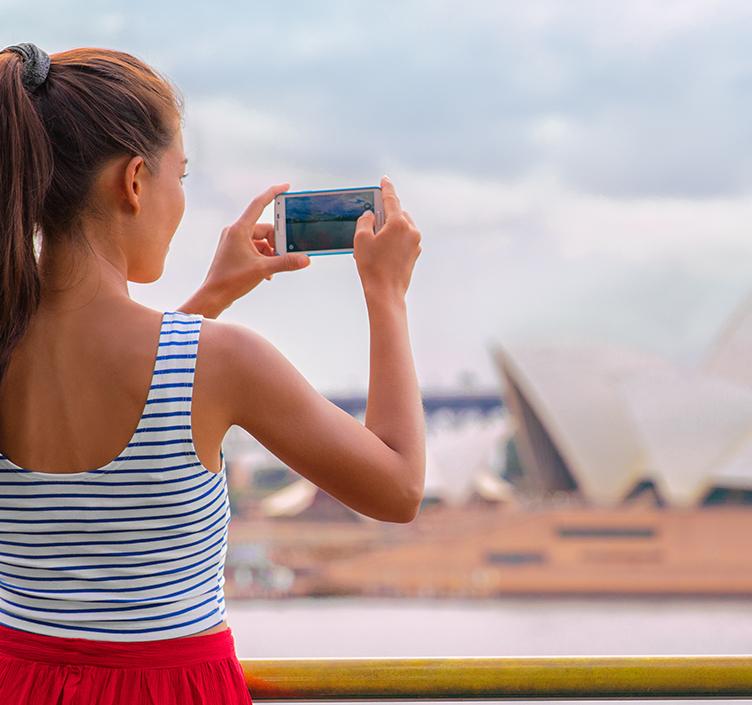 Girl taking photo of Sydney Opera House