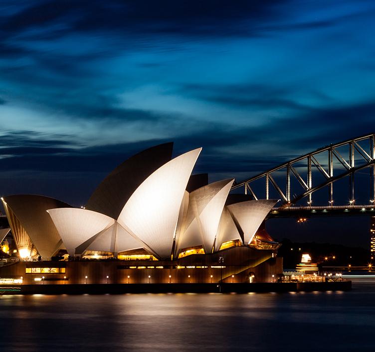 Sydney harbour bridge lit up at night