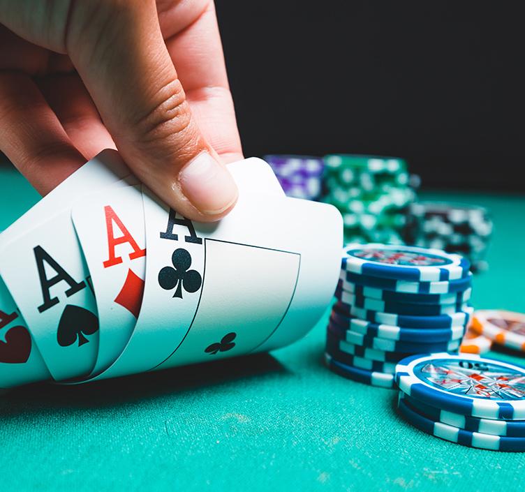 Gambler holding Aces
