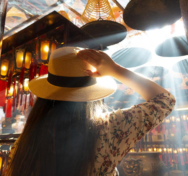 Lady visiting temple in Hong Kong