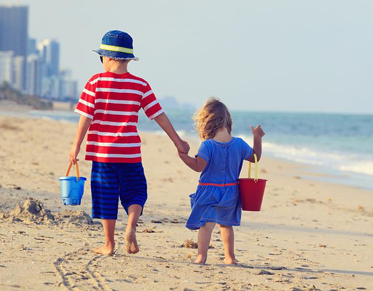 Children walking along Miami Beach