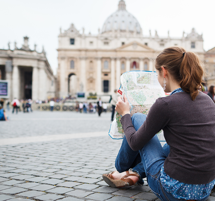 Lady looking at map in Rome
