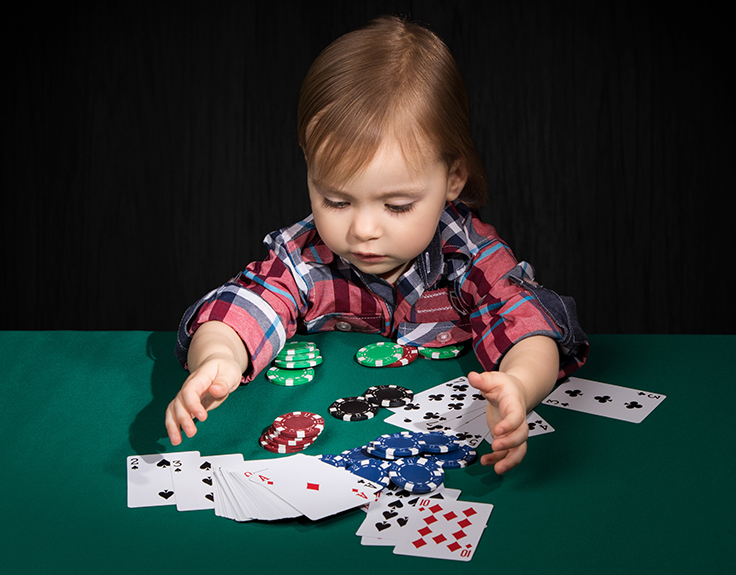 Child playing poker!