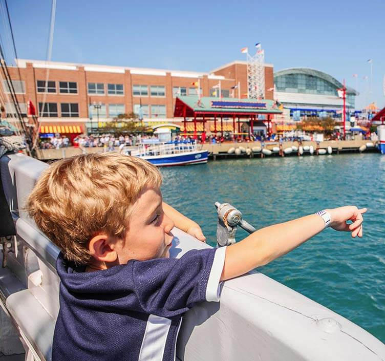 Kid pointing at water