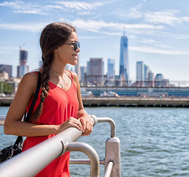 Woman on a boat with New York skyline in the background