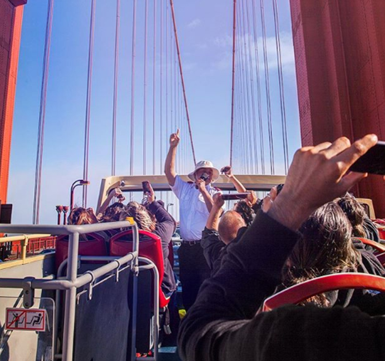 A Big Bus tour with onboard guide driving over the Golden Gate Bridge in San Francisco