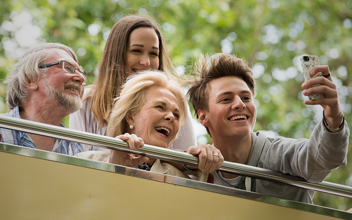Family taking a selfie on board with Big Bus Tours Dublin