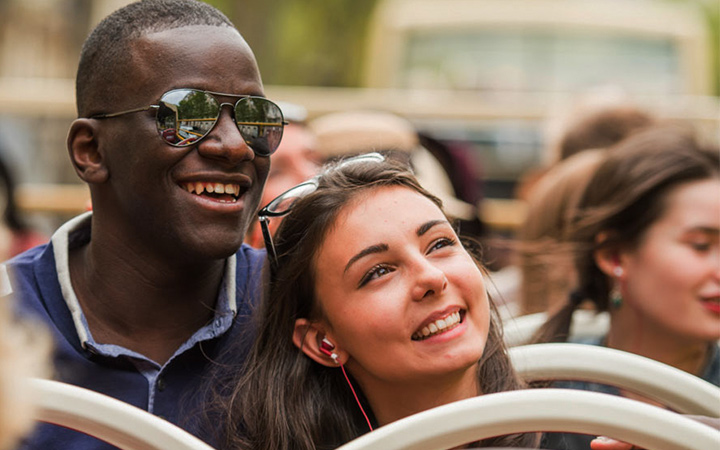 Entertained couple on sightseeing bus tour