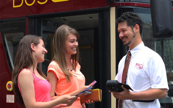 Women Buying Flexible Big Bus Tours Tickets