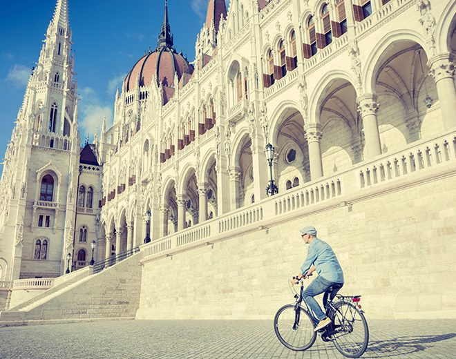 A tourist cycling and sightseeing in Budapest
