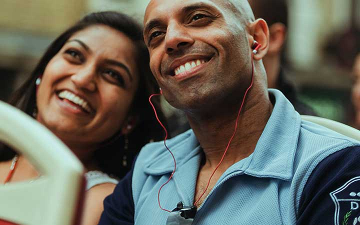 Couple listening to on-board commentary