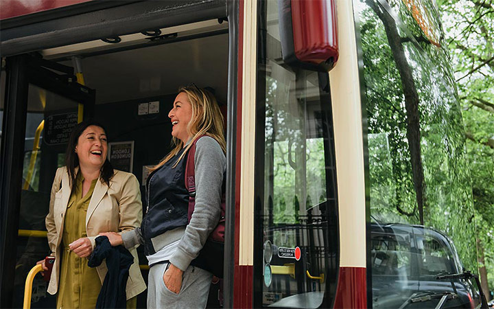 Laughing women hop off Istanbul bus tour