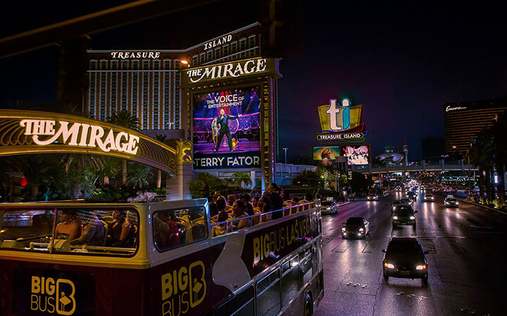 Big Bus Tours passes neon-lit casinos