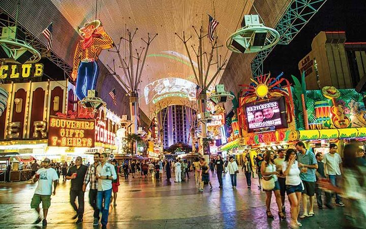 People walking through the Fremont Street Experience