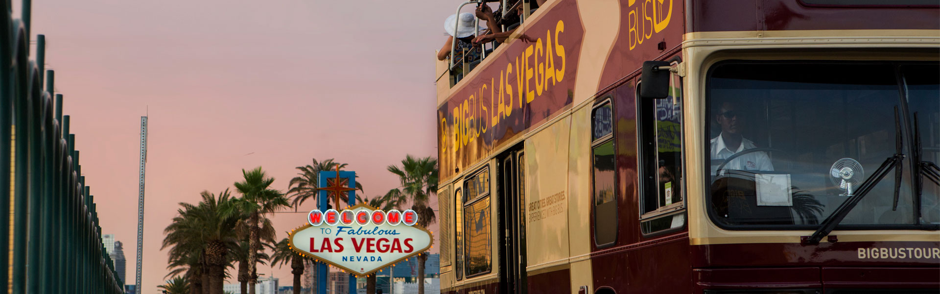 Big Bus Tours Las Vegas Bus with Welcome To Fabulous Las Vegas Sign in background