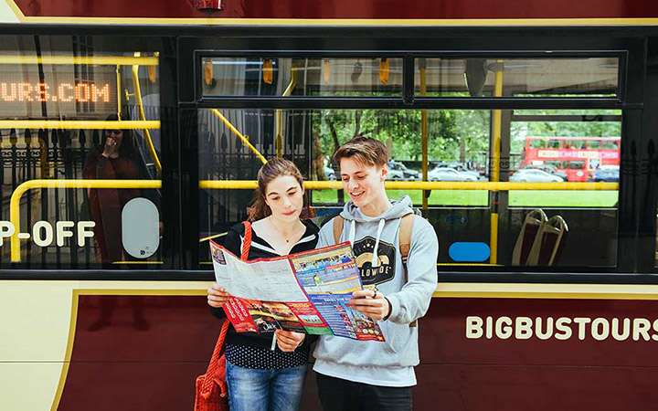 Couple looking at Big Bus Tours map