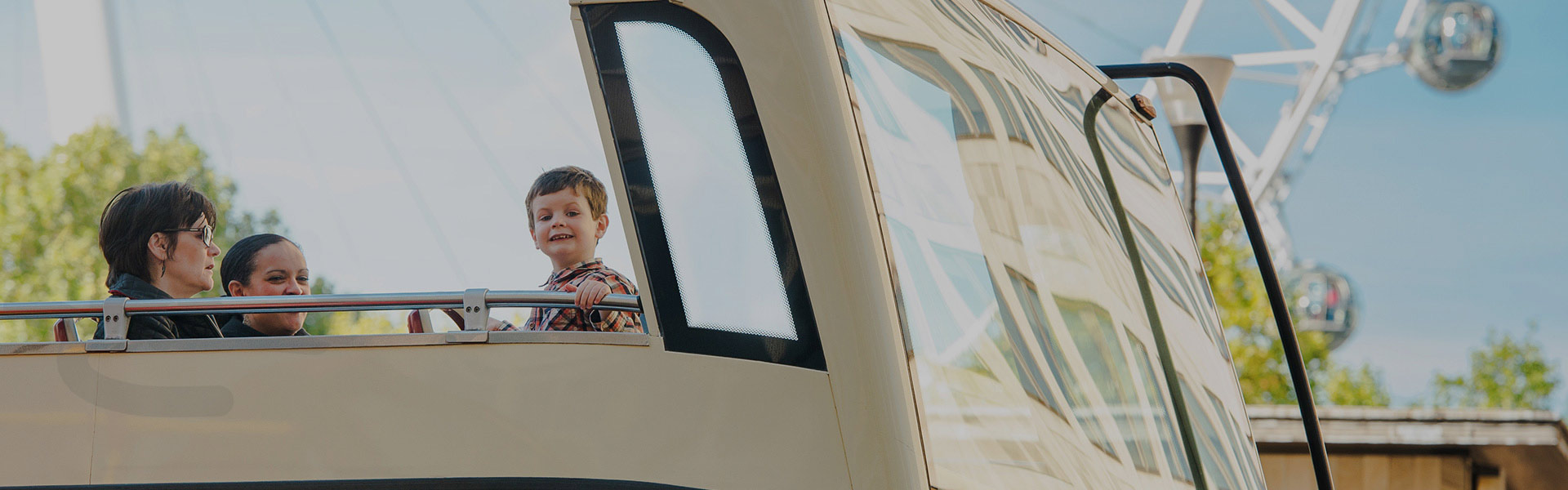 Child on Big Bus tour in London
