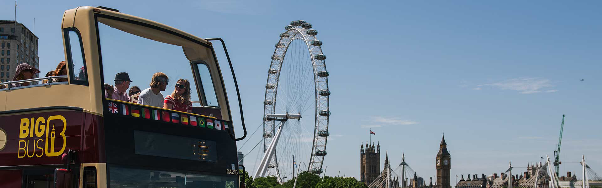 Big Bus Tours passing in front of London Eye