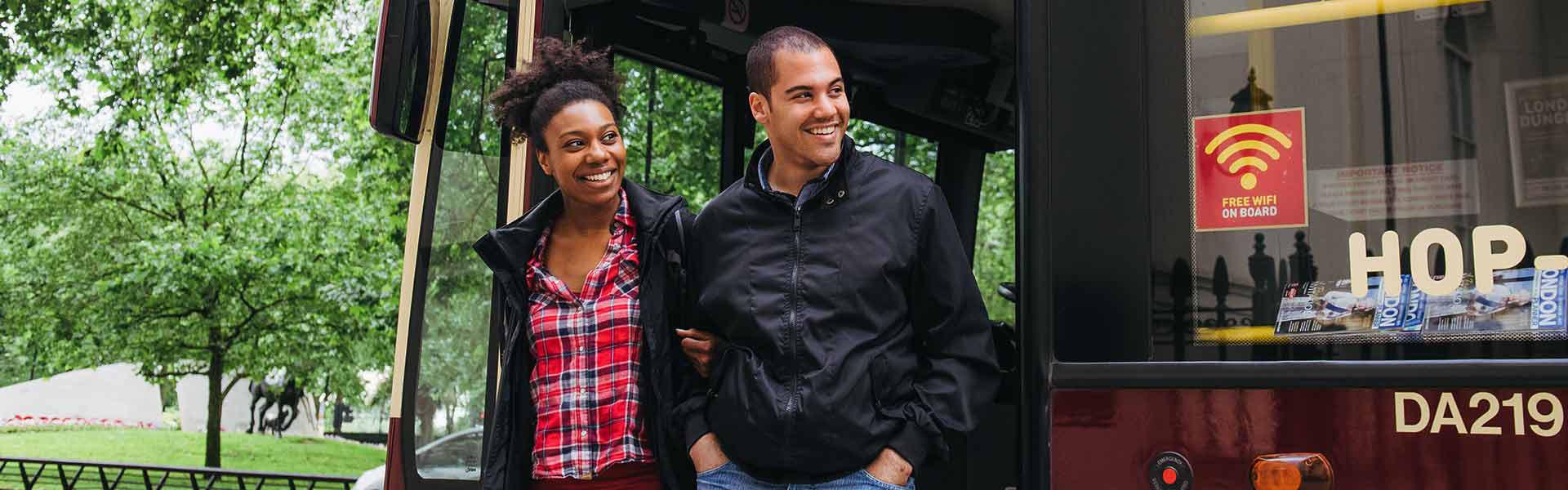 Couple hop off Big Bus Tours London