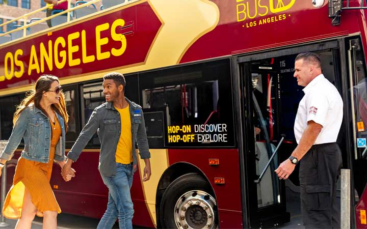 Couple hopping on a Big Bus Tour in Los Angeles