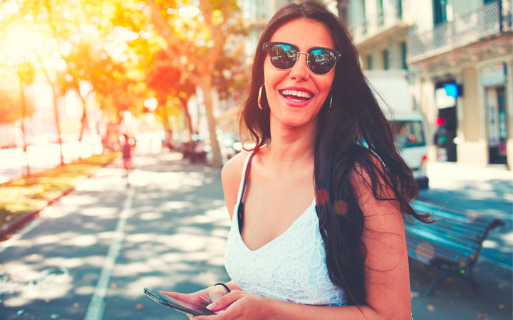 Smiling Woman using The Big Bus Tours Los Angeles App
