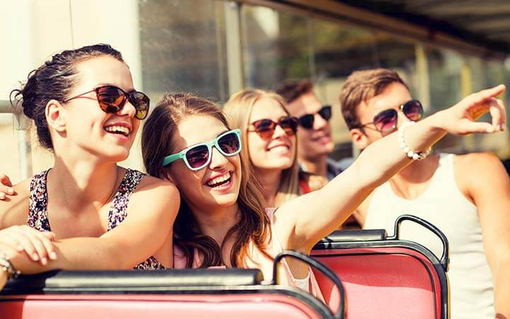 Group of teens laughing on top deck of Big Bus Tours Los Angeles Bus