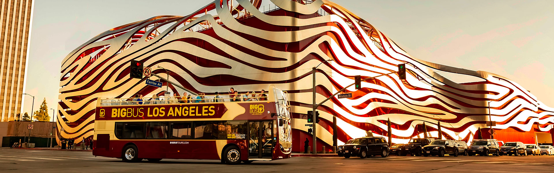 View of Big Bus Tours passing Peterson Automotive Museum