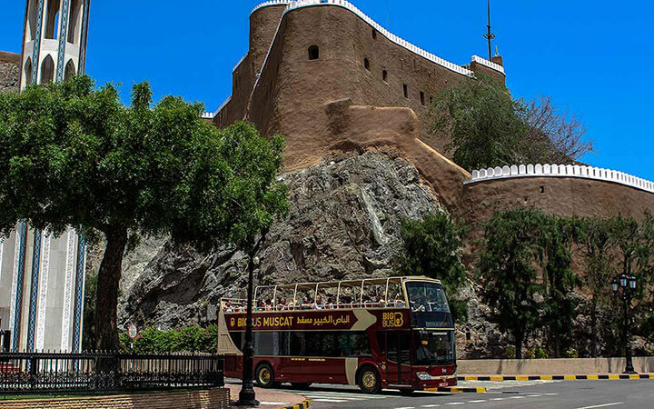 Bus passing Muscat fort